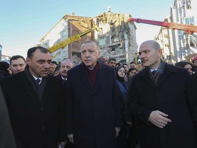 Turkish president visits quake scene and denies they were unprepared