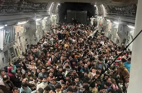 Striking image appears to show 640 people fleeing Kabul in packed US military plane